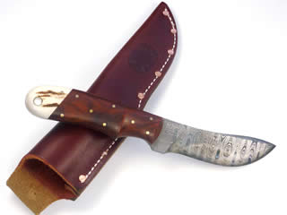 "150 layer ladder pattern 3 3/4"" long Damascus blade with Cocobolo and elk horn handle"
